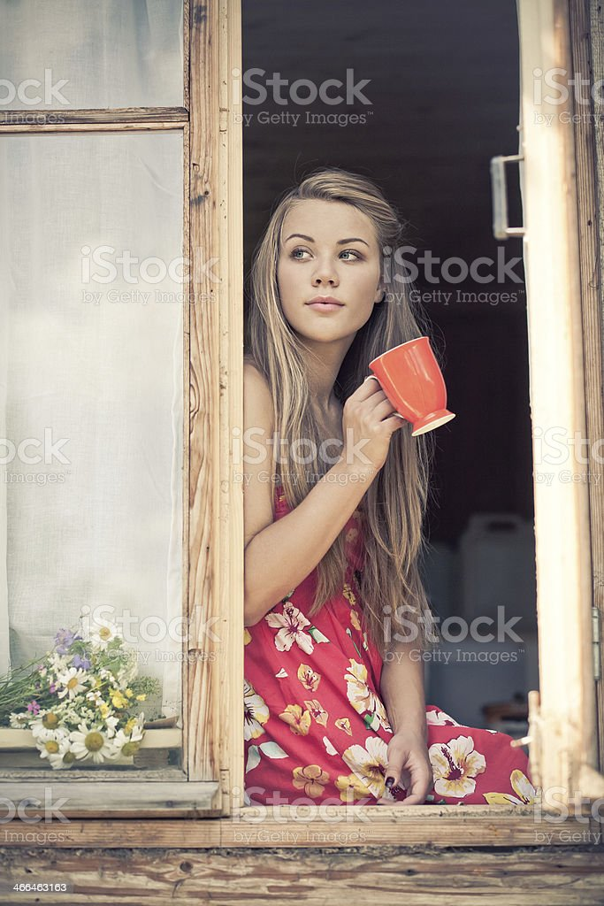 Young woman is drinking tea stock photo