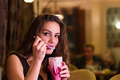 Young woman is eating whipped cream drink