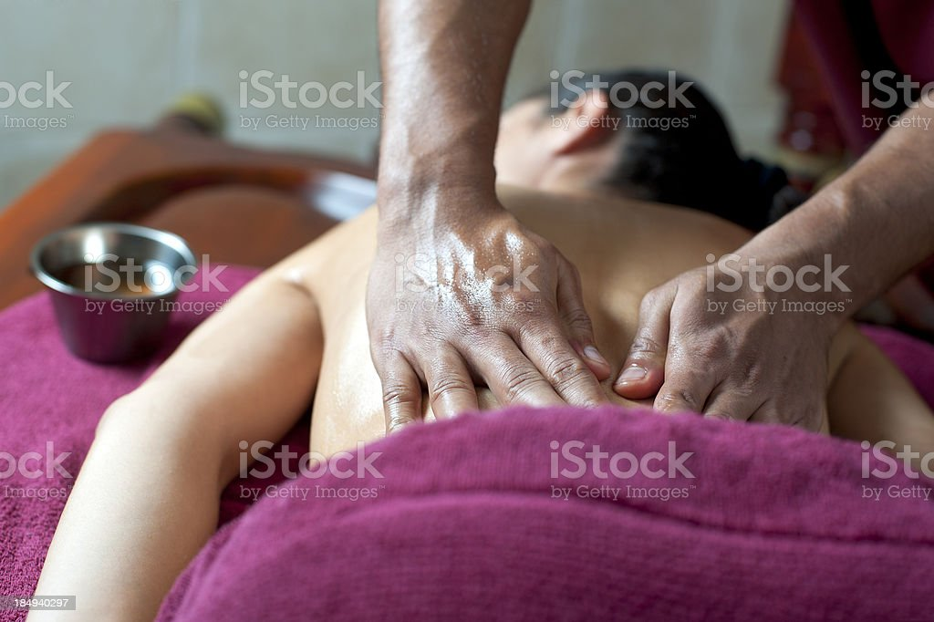 young woman is getting an ayureveda massage royalty-free stock photo