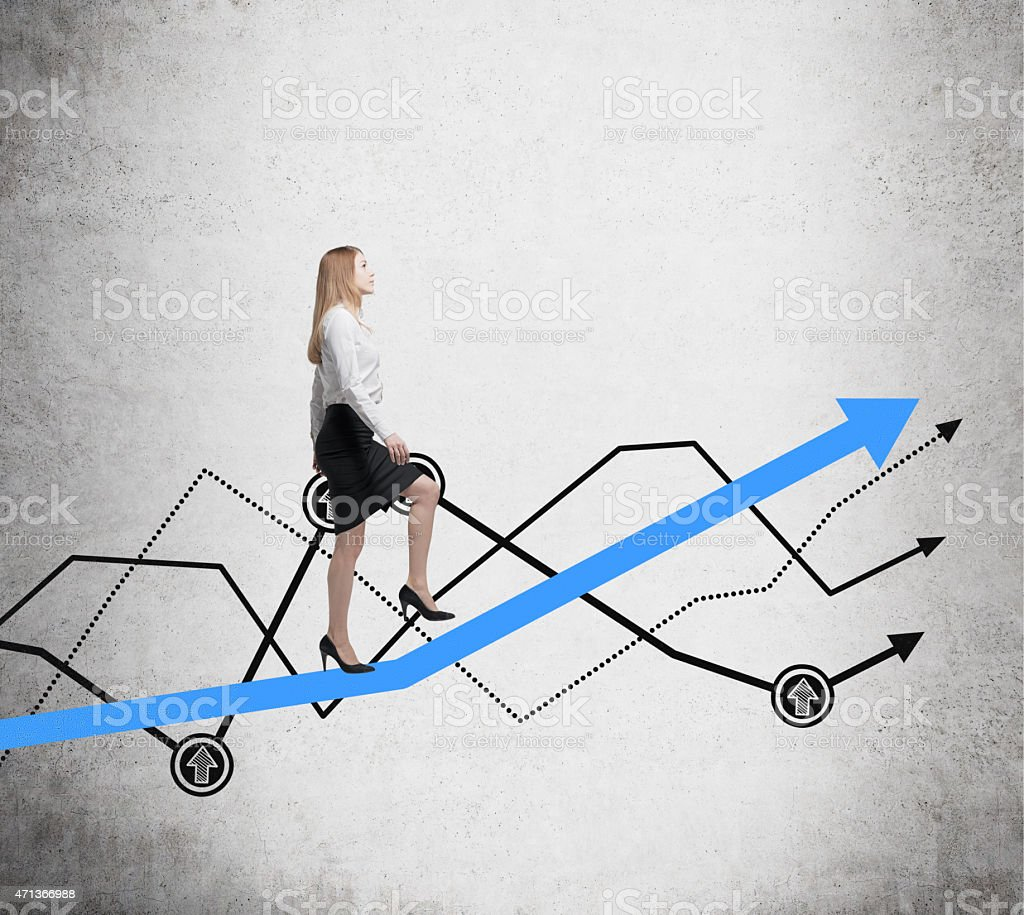 Young woman is going up to the line graph stock photo