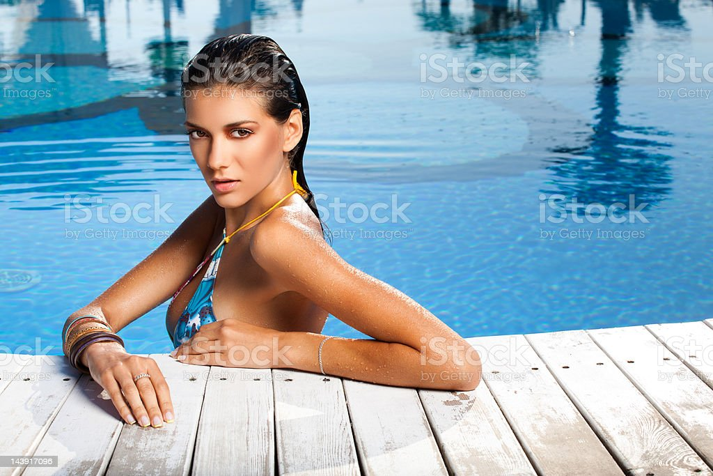 Young woman is in a pool stock photo