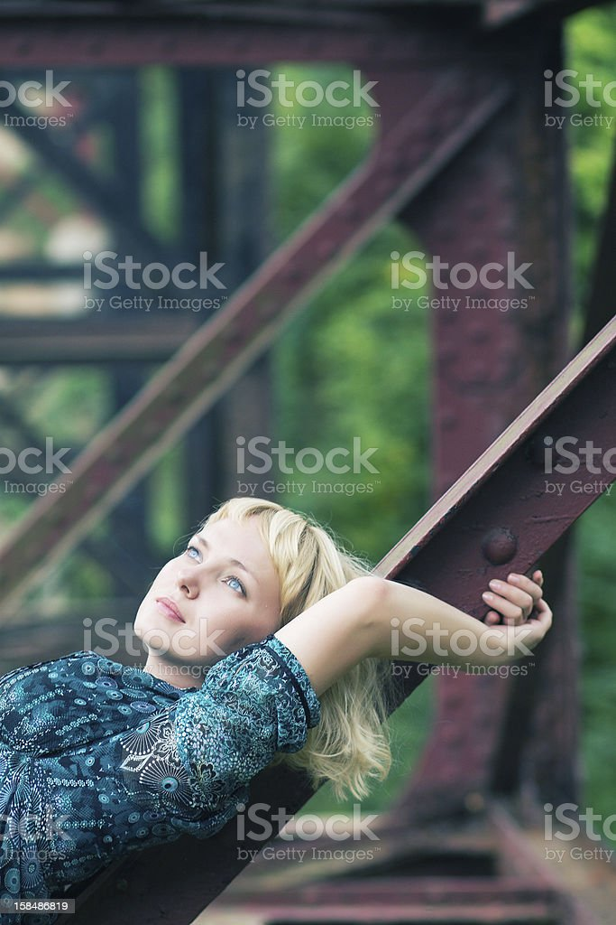 young  woman is  on bridge bearing royalty-free stock photo