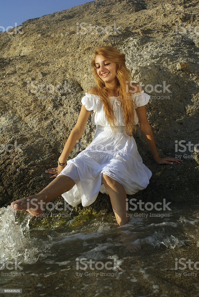 young woman is playing with water stock photo
