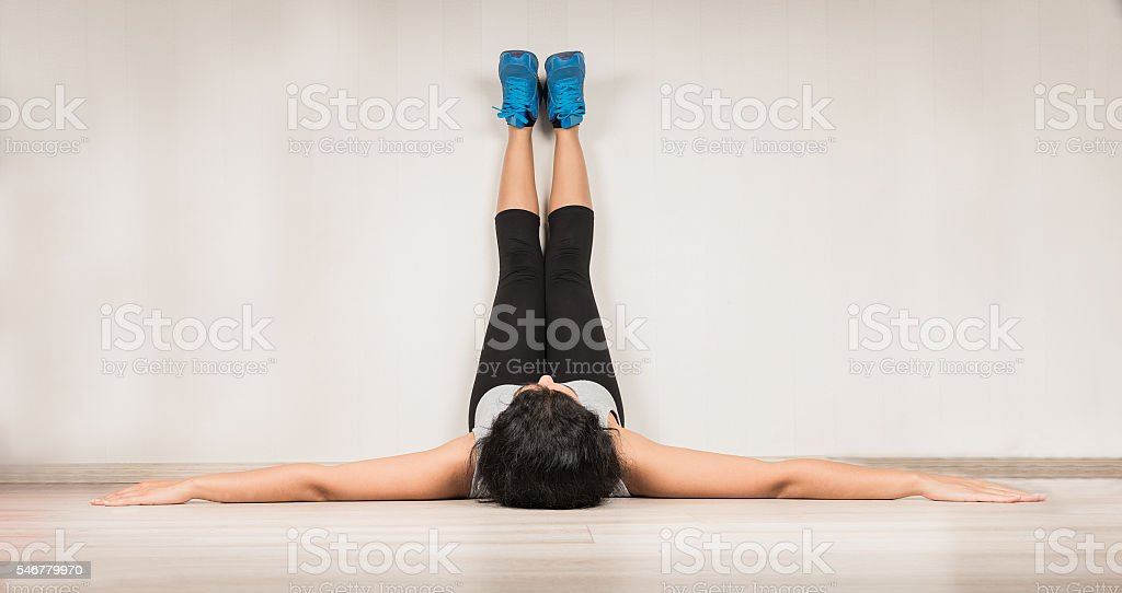 Young woman is relaxing after fitness stock photo