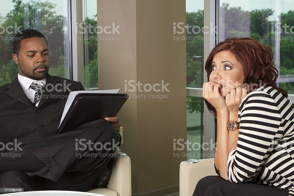 Young woman is scared during a job Interview royalty-free stock photo
