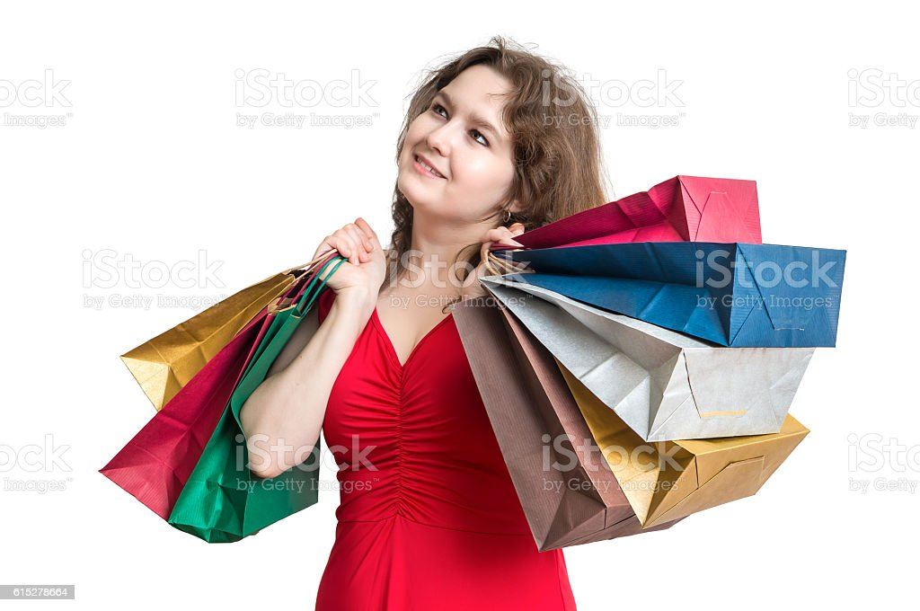 Young woman is shopping and holds many bags in hands. stock photo
