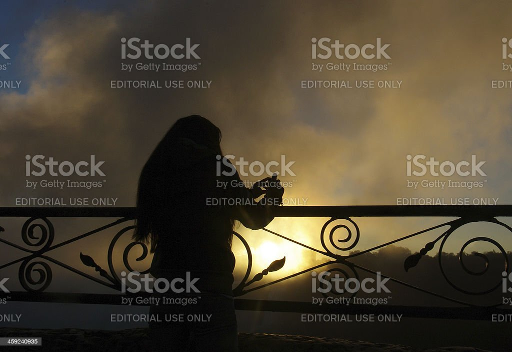 Young woman is taking pictures at Niagara Falls stock photo