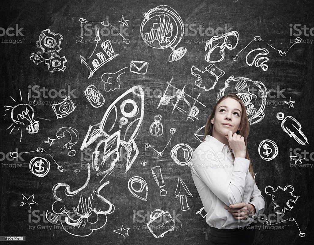 Young woman is thinking about future education opportunities stock photo