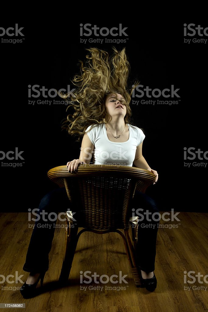 young woman is tossing her hair royalty-free stock photo
