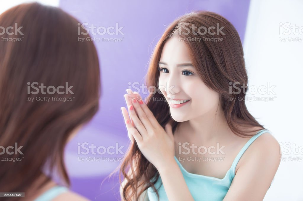 young woman is touching hair stock photo