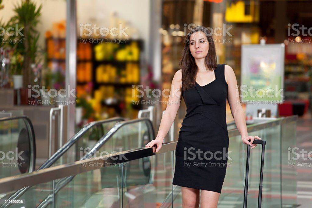 Young woman is waiting for somebody stock photo