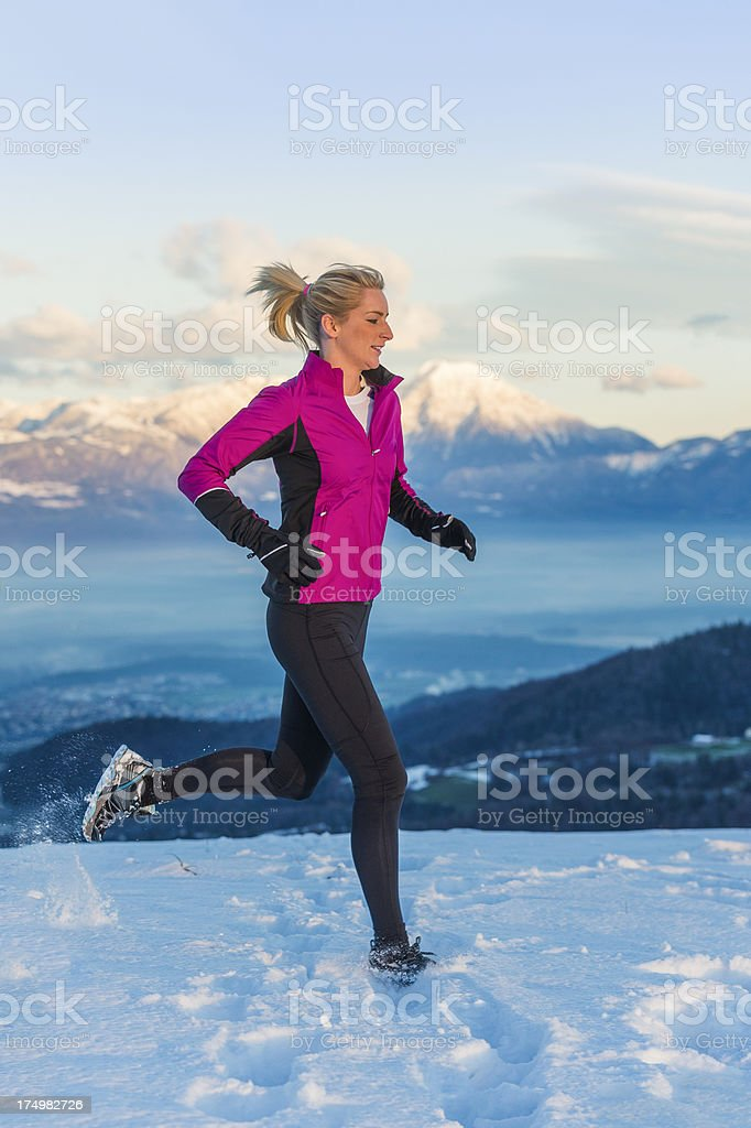 Young woman jogging at sunset stock photo