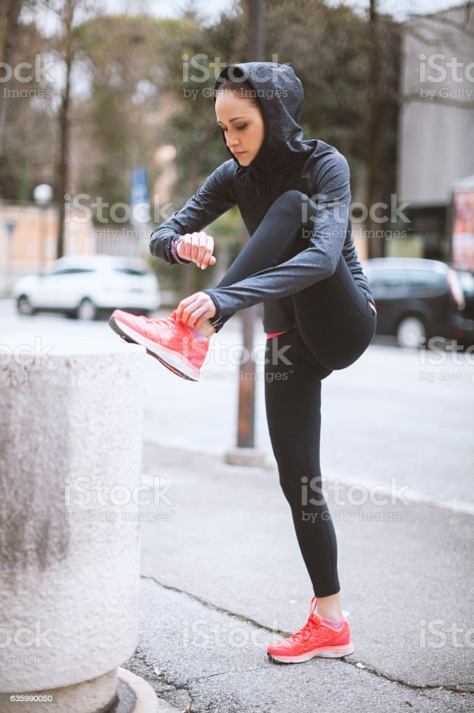 Young Woman Jogging in the City stock photo