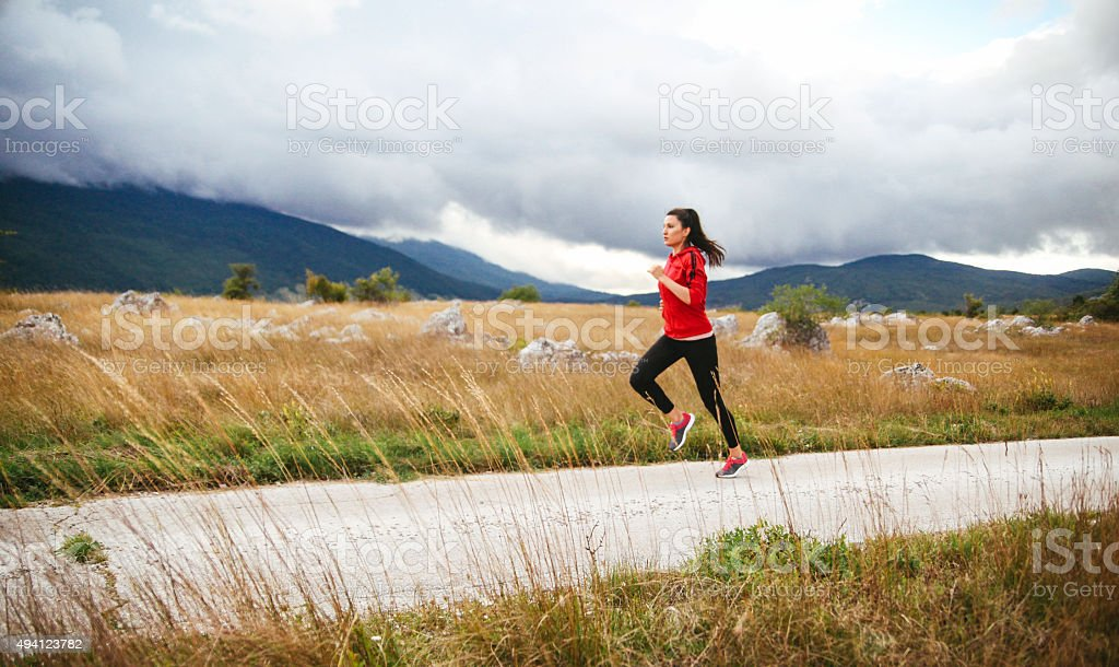 Young woman jogging in the nature stock photo