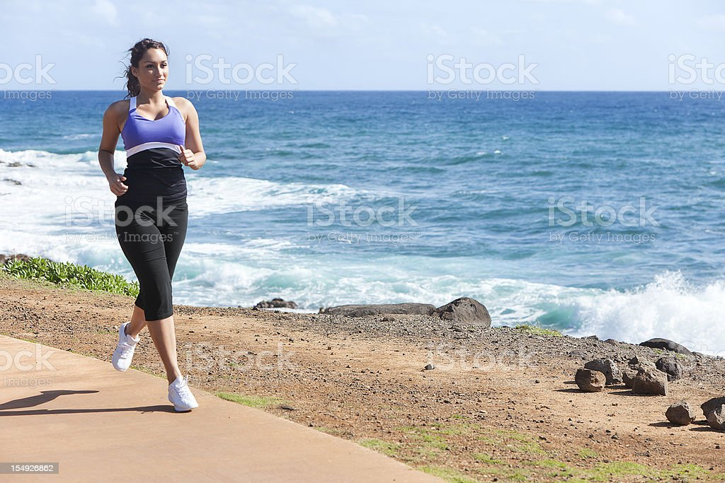 Young Woman Jogging Near Ocean royalty-free stock photo