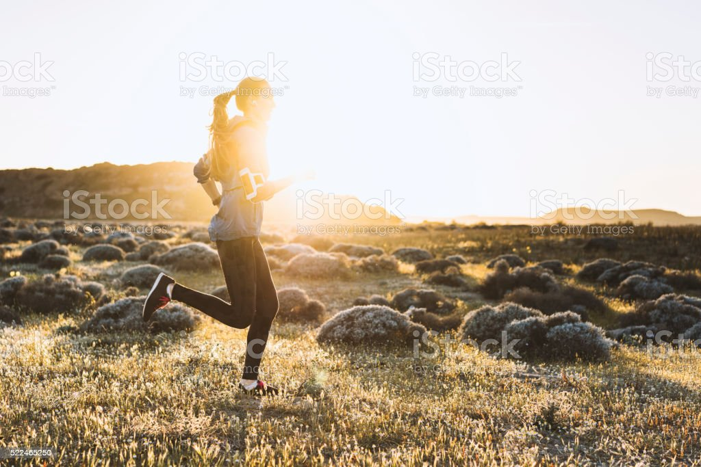 Young woman jogging on a sunny day stock photo