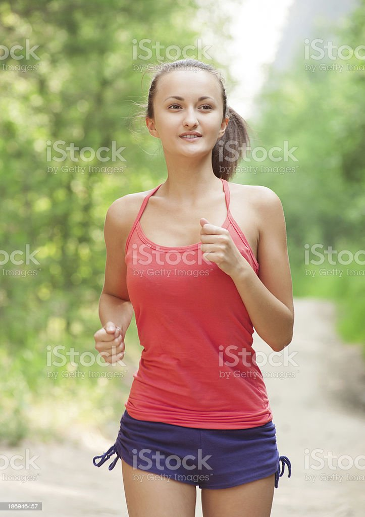 Young woman jogging outdoors royalty-free stock photo