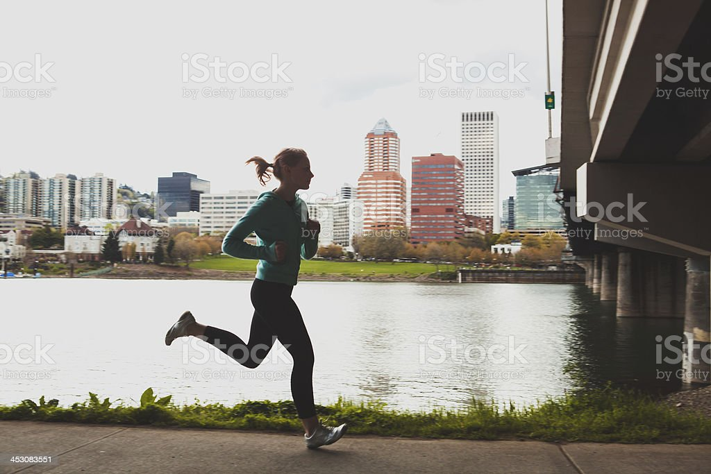Young Woman Jogging Running For Exercise In the City stock photo