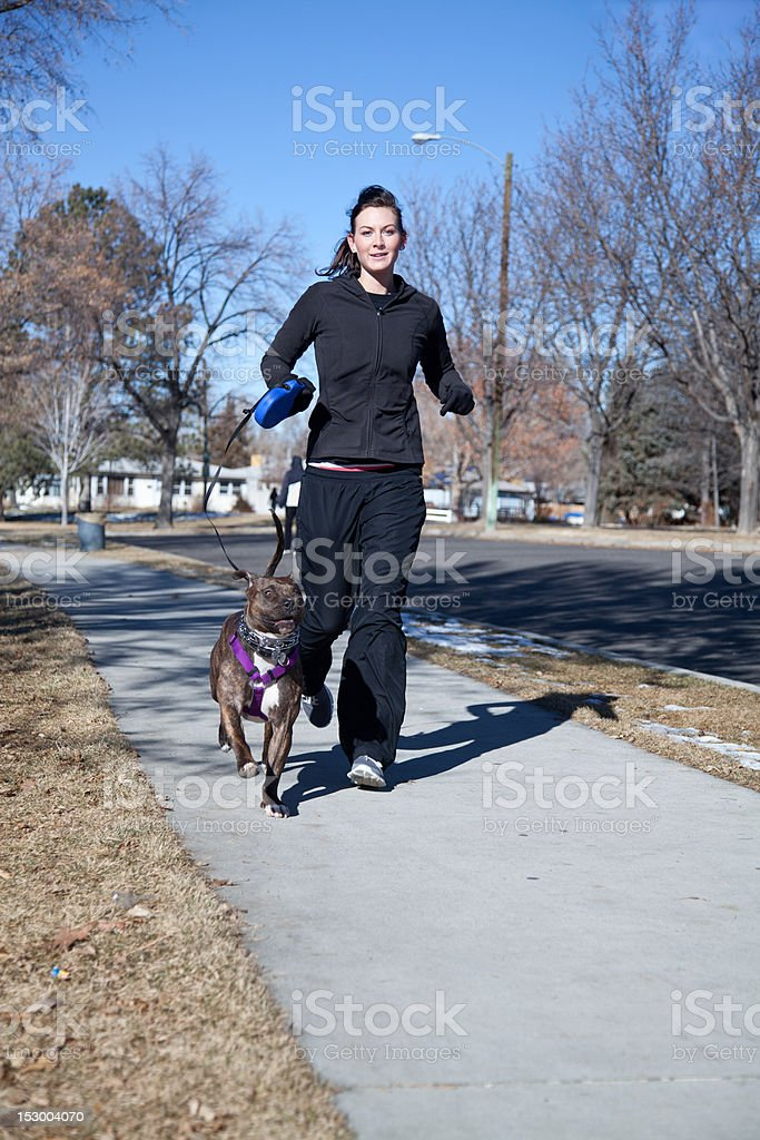 Young Woman Jogging with her dog. royalty-free stock photo