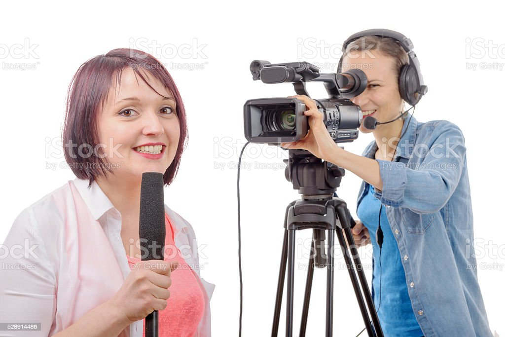 young woman journalist with a microphone and camerawoman stock photo
