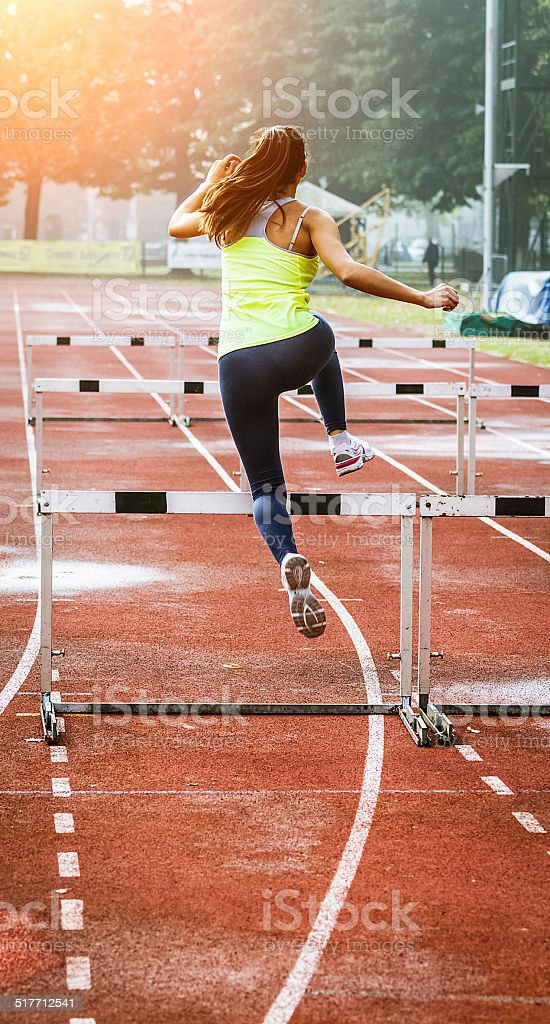 Young woman jump during Hurdle Race stock photo