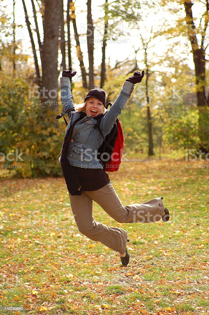Young woman jumping in the air stock photo