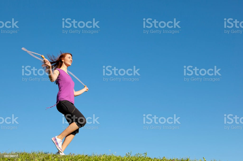 Young woman jumping rope royalty-free stock photo
