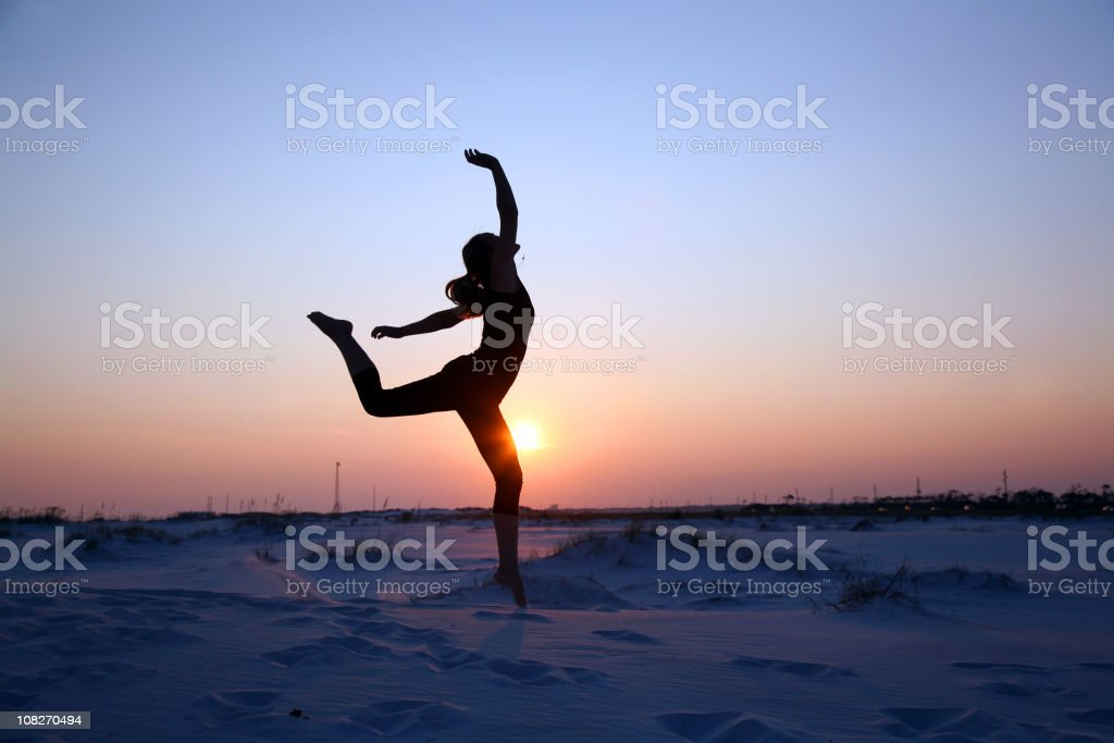Young Woman Jumps High Silhouette royalty-free stock photo