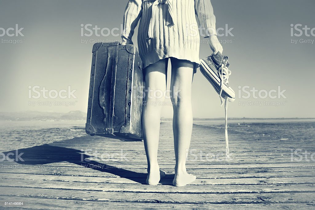 young woman just arrived to destination with her suitcase stock photo