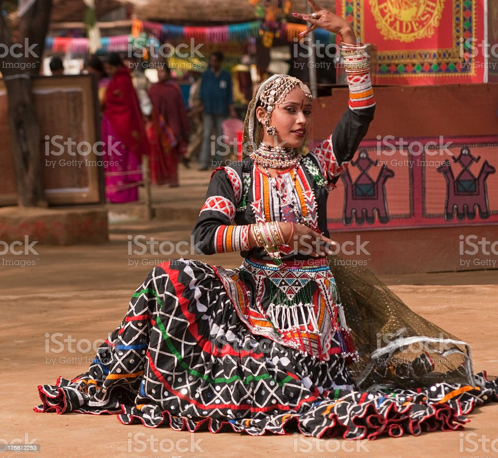 Young woman kalbelia dancer in colorful dress stock photo