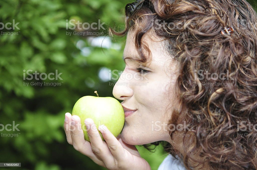 Young woman kisses an apple stock photo