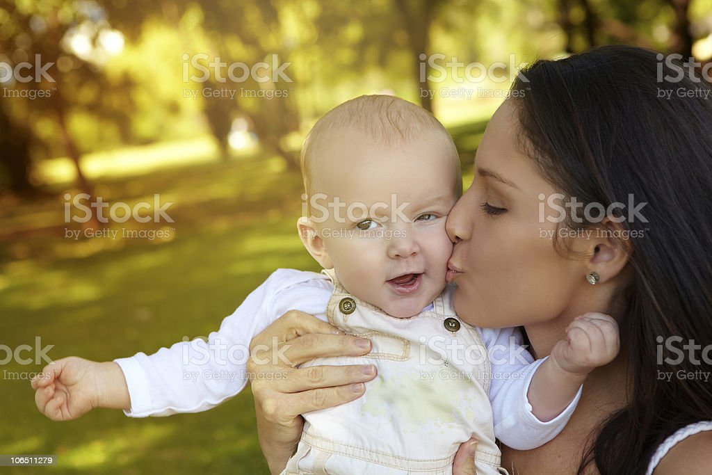 young woman kissing her baby royalty-free stock photo