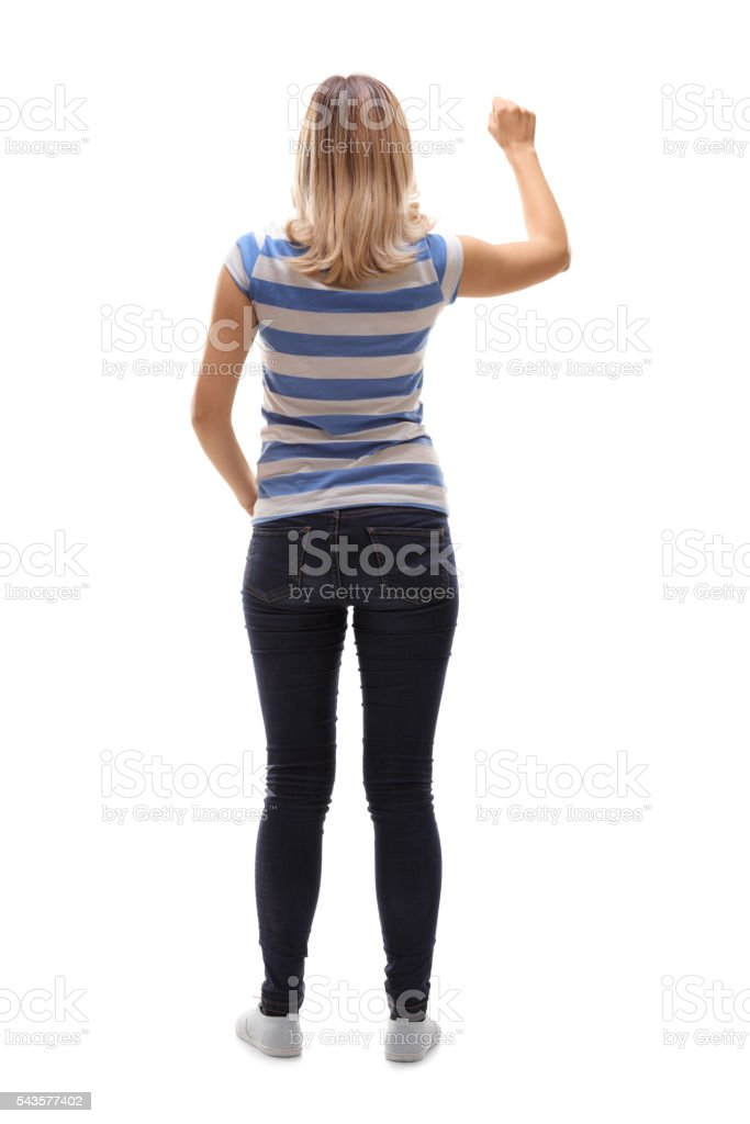 Young woman knocking on a door stock photo