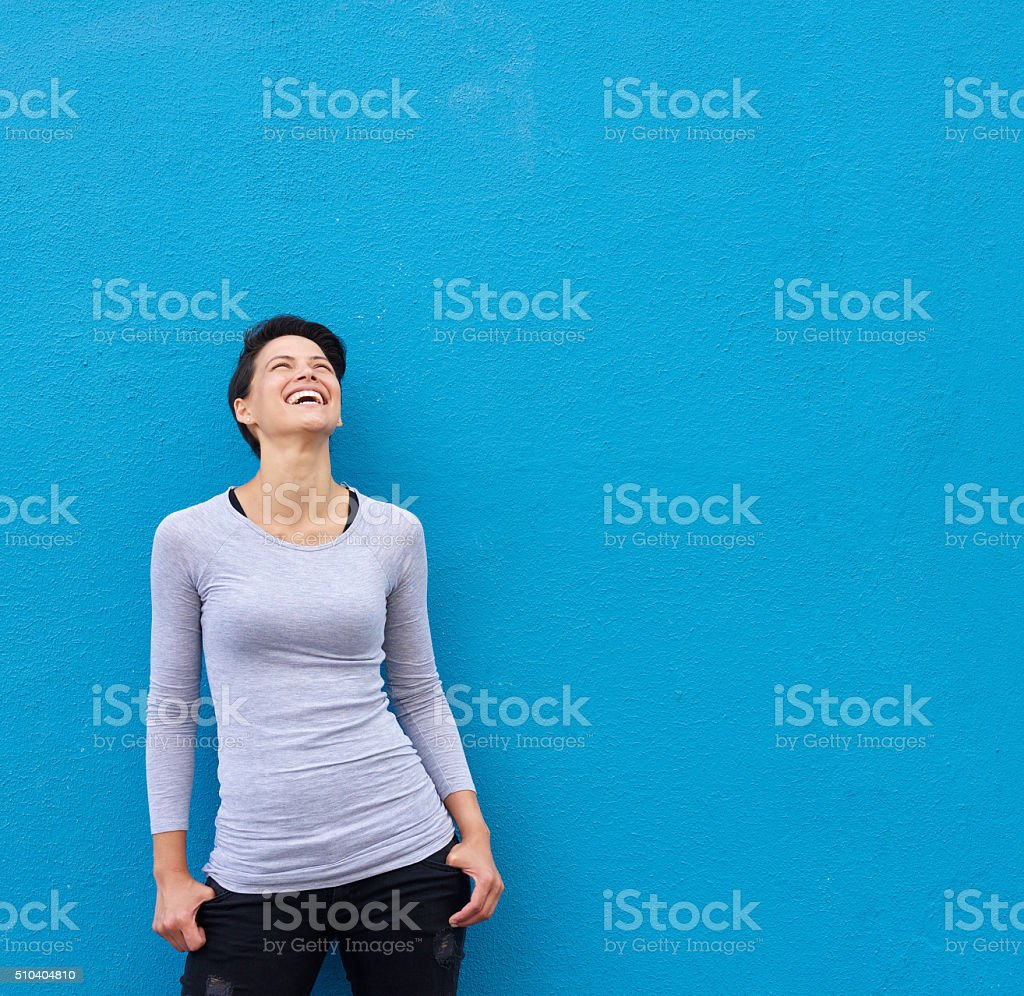 Young woman laughing and looking up stock photo