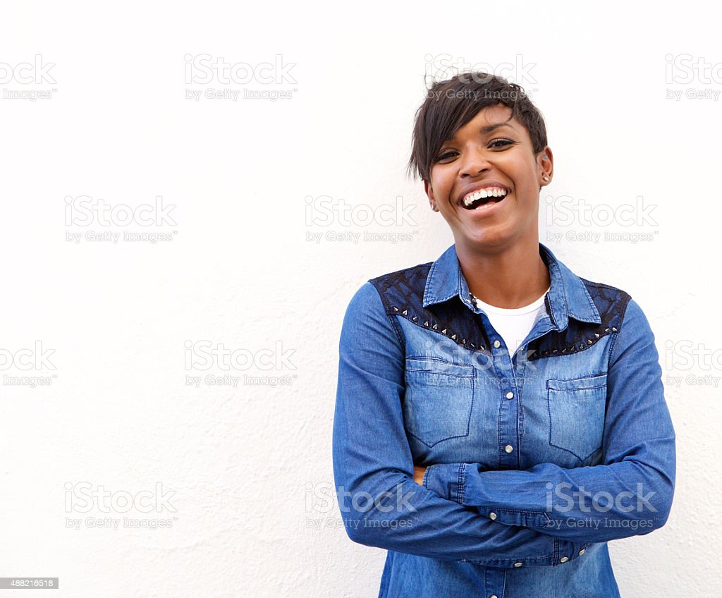 Young woman laughing with arms crossed stock photo