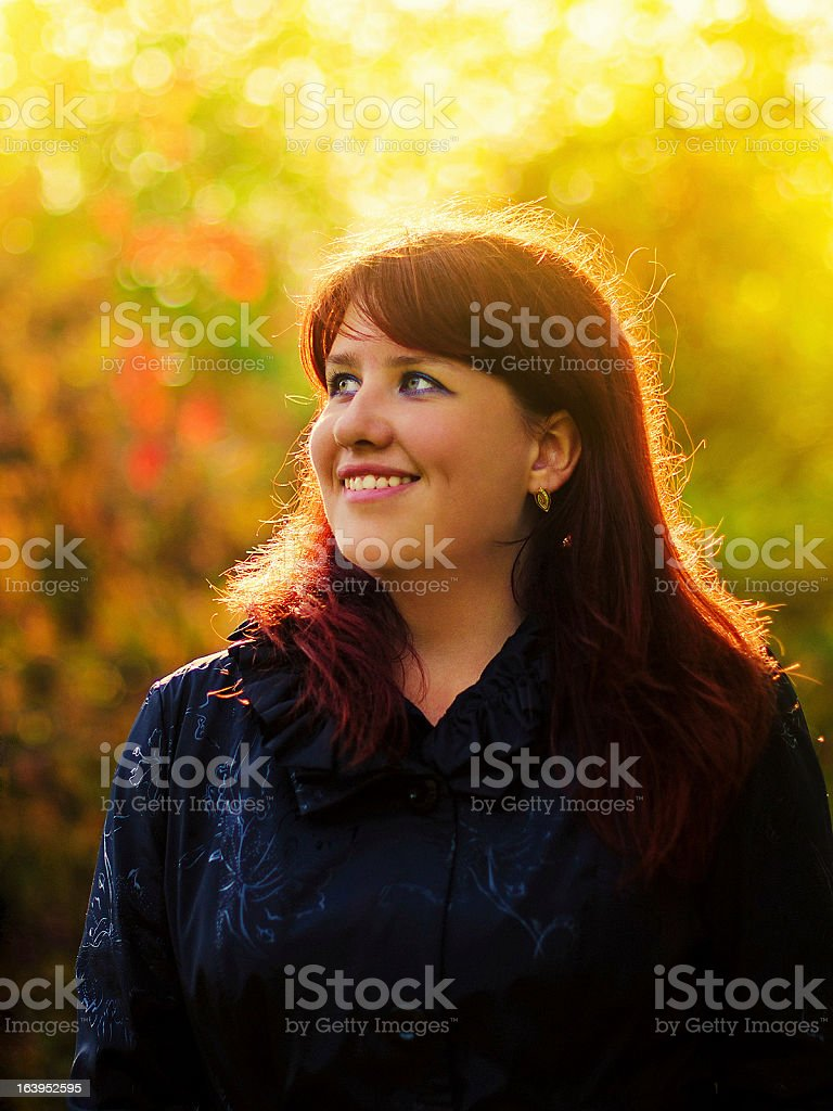 Young woman laughs in the sunny spring park royalty-free stock photo