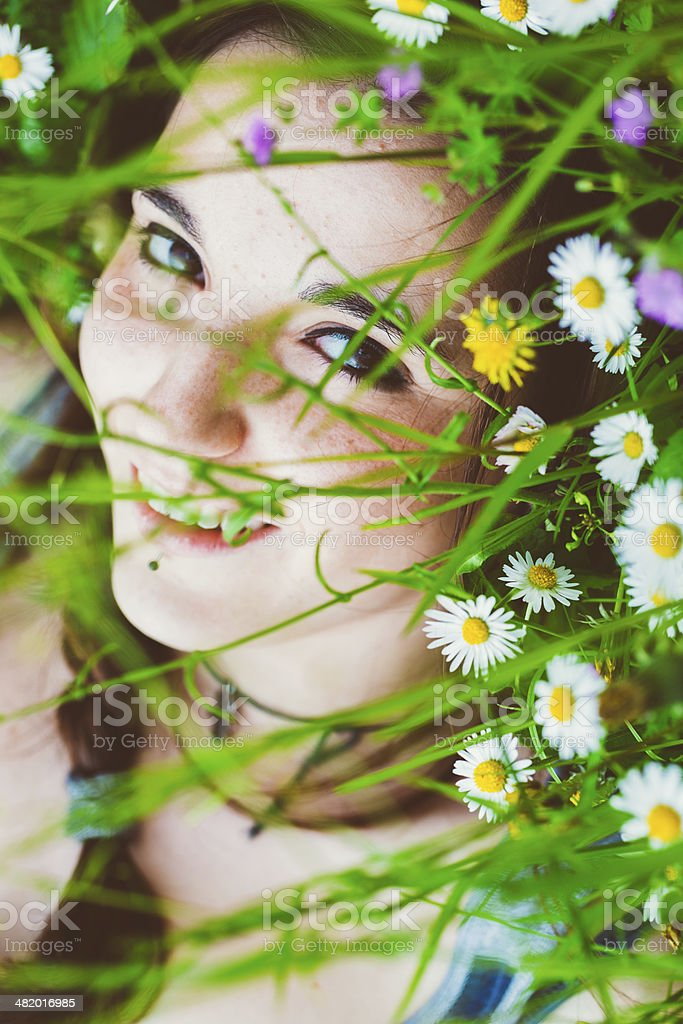 Young Woman laying in Spring park royalty-free stock photo