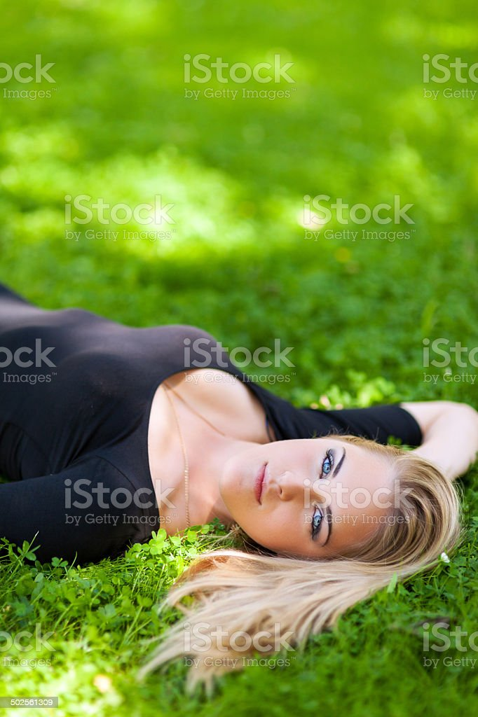 Young woman laying on the grass royalty-free stock photo