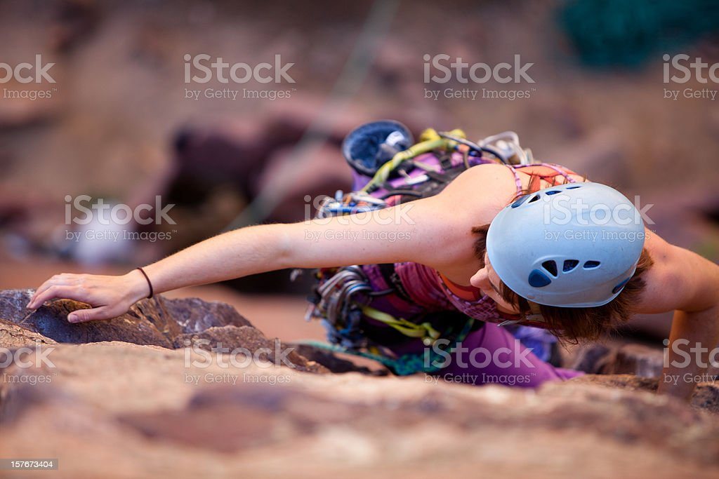 Young woman leading a climbing route in Colorado stock photo
