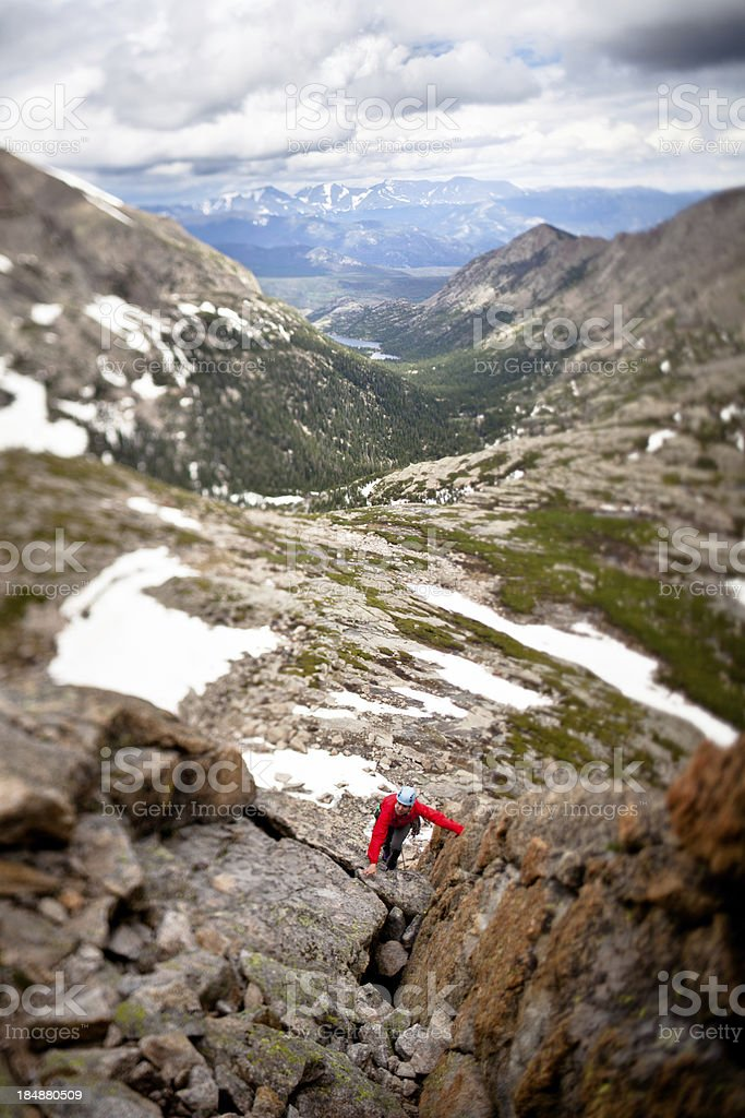 Young woman leading a climbing route in Colorado royalty-free stock photo
