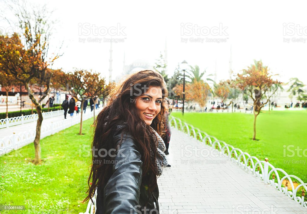 Young Woman Leading You In The Park Pavements stock photo