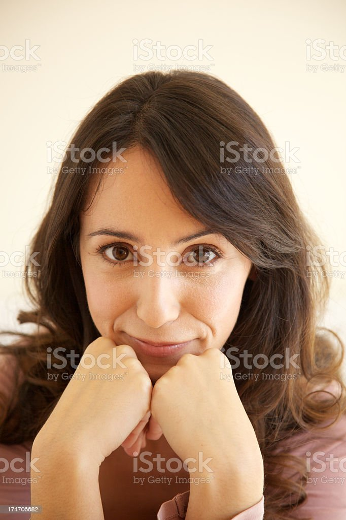 Young woman leaning her head on hands portrait stock photo