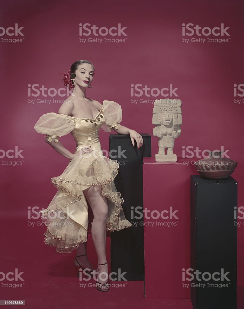 Young woman leaning near antique, smiling, portrait royalty-free stock photo