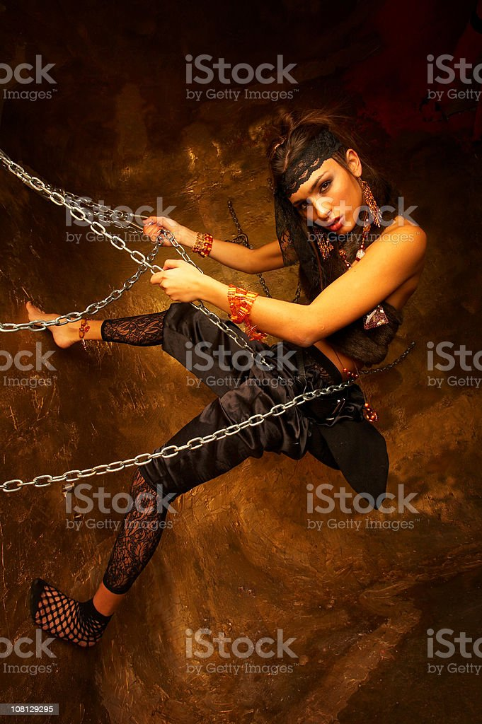 Young Woman Leaning on Chains royalty-free stock photo
