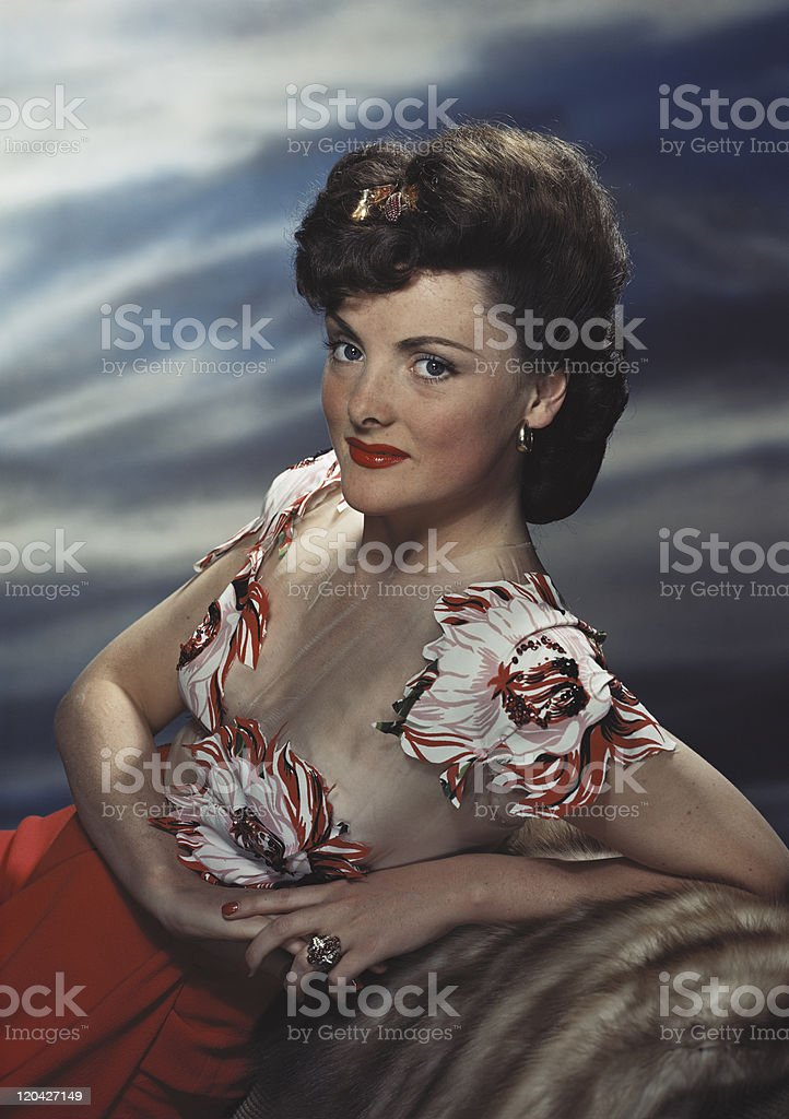 Young woman leaning on rock, smiling, portrait royalty-free stock photo