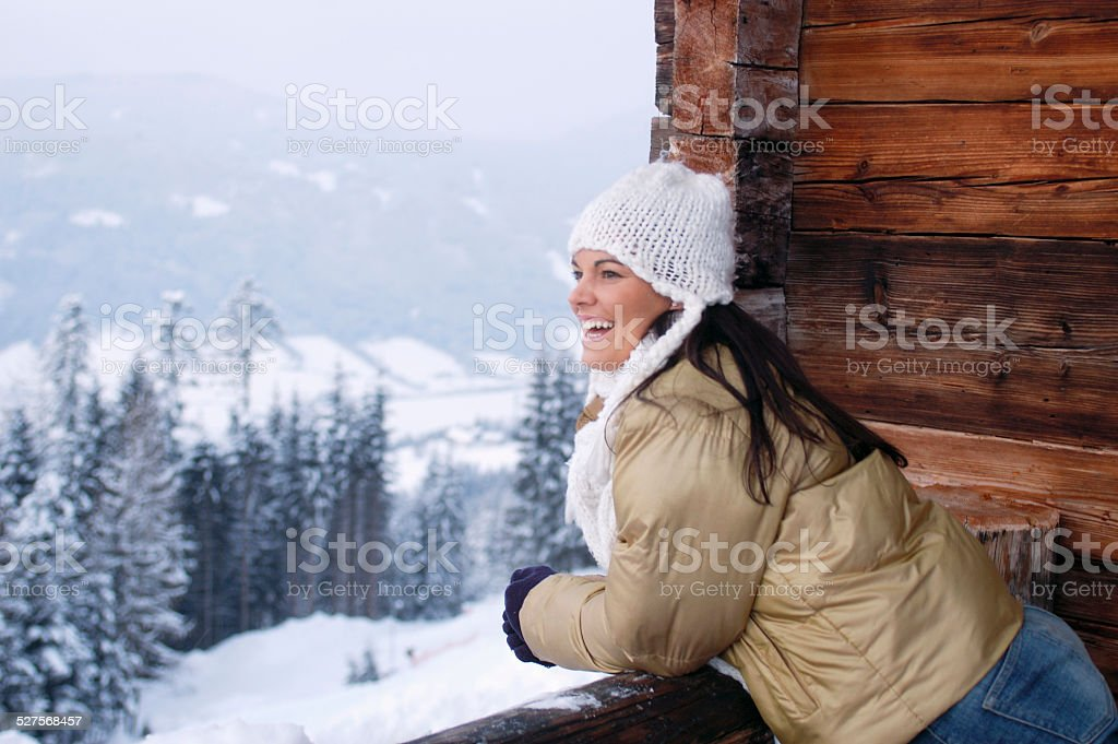 Young woman leaning out, smiling stock photo
