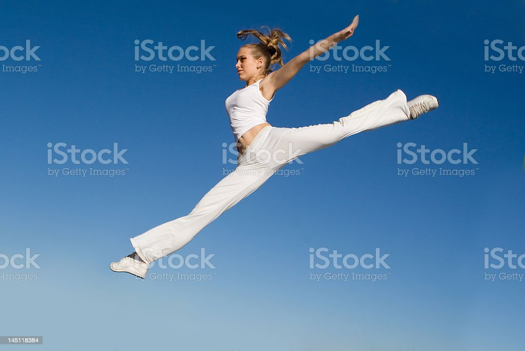 young woman leaping royalty-free stock photo