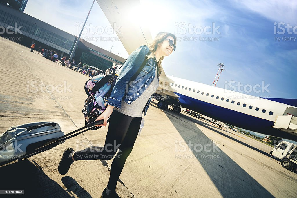 Young woman leaving for vacations stock photo