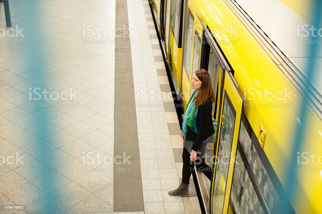 Young woman leaving the commuter train stock photo