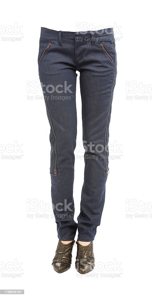 Young woman legs in zipped jeans and crocodile leather pumps royalty-free stock photo